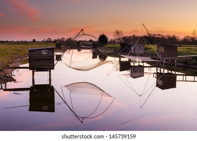 Reflection of fisheries on the river, La Barre de Monts, France