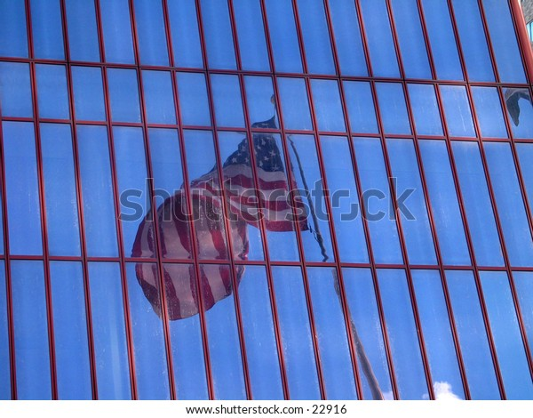 Reflection of flag in window.