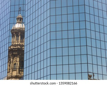 Reflection in a glass building of the Metropolitan Cathedral of Santiago, in the Armas square. It is the main temple of the Catholic Church in the country, built between 1748-1800. Chile