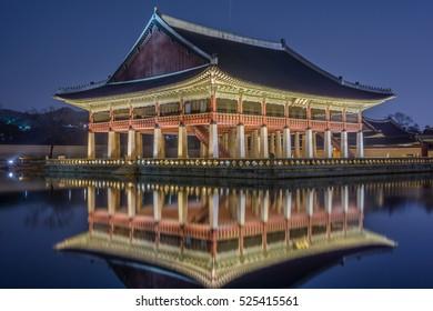 Reflection of Gyeongbokgung palace at night in Seoul, South Korea.