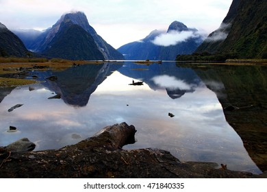 reflection of high mountain glacier at milford sound, New Zealand