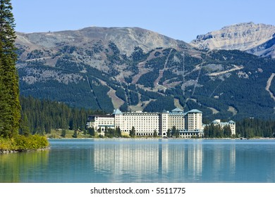 Reflection of the hotel Chateau Lake Louise in Lake Louise with the Lake Louise ski hill visible behind.