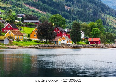 Reflection of houses in a norwegian fjord, Norway