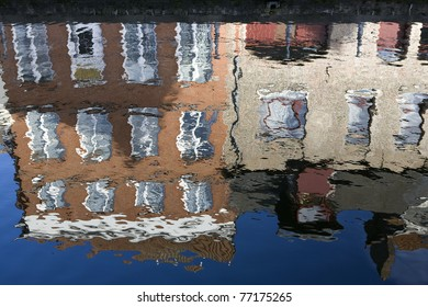 Reflection of houses on a canal in Bruges, Belgium.