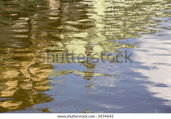 Reflection from houses in the spring river