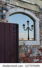 Reflection of Italian light post on a window