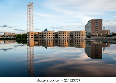 Reflection of the John G. Diefenbaker Building in the Rideau river in Ottawa Canada at sunset.