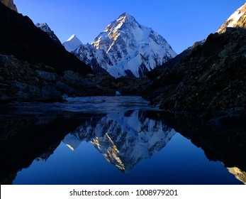 The Reflection of K2 (8,611 m), the second highest mountain in the world, Central Karakoram, Gilgit-Baltistan, Northern Pakistan