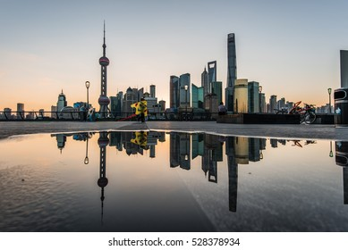 Reflection of kiter in front of the Shanghai Skyline, early morning