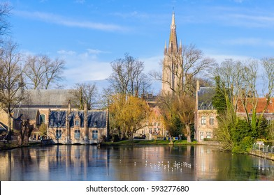 Reflection in the lake in the Minnewater Park in the UNESCO World Heritage Old Town of Bruges, Belgium