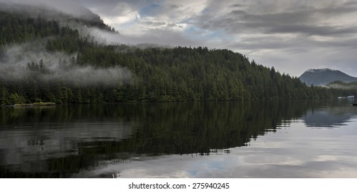 Reflection of landscape on water, Skeena-Queen Charlotte Regional District, Haida Gwaii, Graham Island, British Columbia, Canada