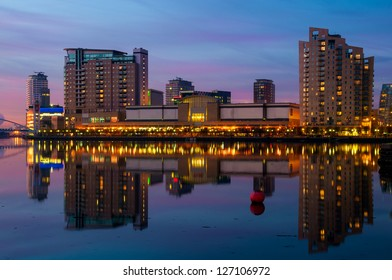 Reflection of Manchester, Salford quays skyline in the waters of Manchester Canal.