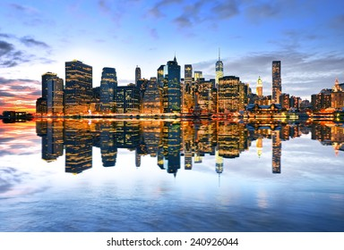 Reflection of Manhattan skyline at twilight.