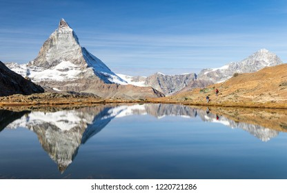 Reflection of Matterhorn peak over Riffelsee in Zermatt, Switzerland in autumn season, sunny day in mountain