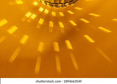 reflection from the mirror ball, the rays of the boat on a yellow background, the rectangular reflection of light on a yellow background, disco ball, minimalism, abstraction, sun buds