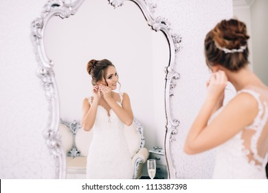 Reflection in the mirror of a beautiful bride. The bride is going to the ceremony