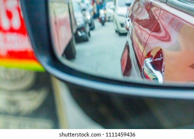 Reflection in mirror and blur traffic jam.