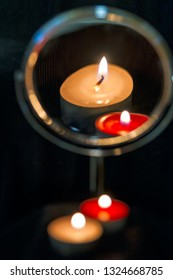 The reflection in the mirror with the rise of two burning candles