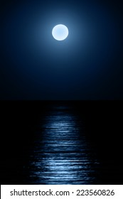 Reflection of the moon on the sea surface. Moonlight path.