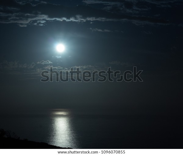 Reflection of the moon over the atlantic ocean from Signal Hill. Western Cape, South Africa