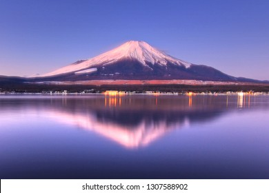 Reflection of Mount Fuji is seen from Yamanakako Lake in the early winter morning