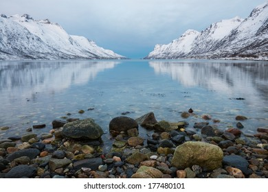 Reflection of the mountain at Ersfjordbotn, Norway.