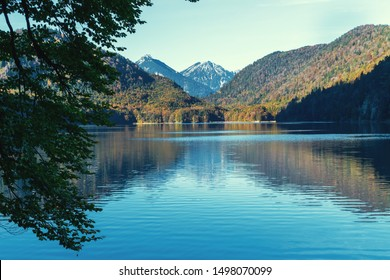 Reflection of a mountain on the surface of lake in the Alps in the morning in autumn