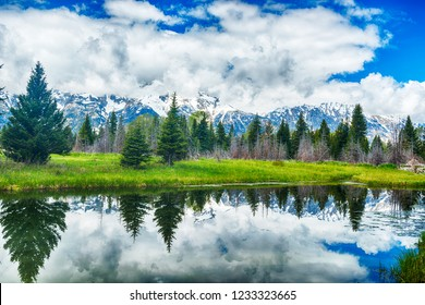 Reflection of the mountain peaks at Schwabacher landing, Grand Teton national park. Wyoming, USA