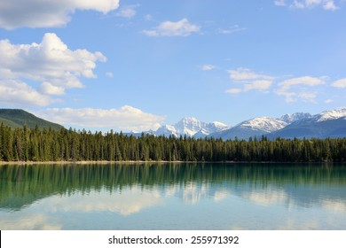 Reflection of Mt Edith Cavell in turquoise lake