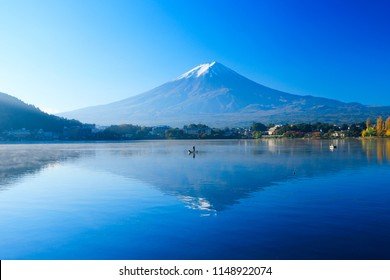 Reflection of Mt. Fuji On the lake surface tha kawaguchiko for here boat is the main equipment for fishing