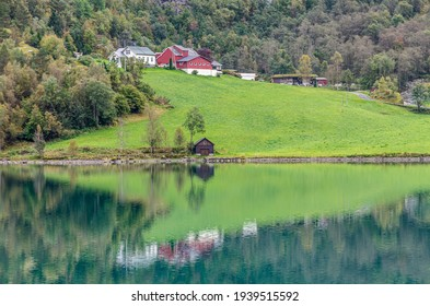 Reflection in Norway fjord at fall time