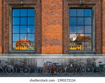 Reflection of Nyhavn (New Haven) at Copenhagen, Denmark. Building and bicycles.