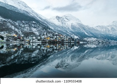 Reflection of Odda in Norway on lake