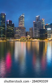 Reflection of office building during twilight in Marina Bay Singapore