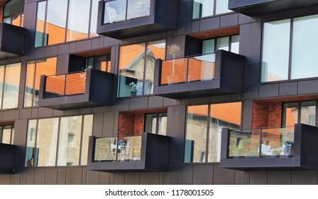 A reflection of an old building in a glass facade of a new building, Copenhagen, Denmark