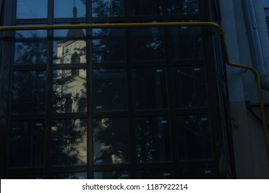 reflection of the  old catholic church in  modern window /contrast of old and modern architecture,spirituality and pragmatism concept