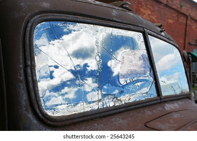 Reflection in an old truck window