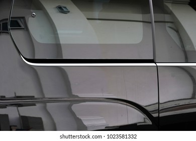 reflection on body of car