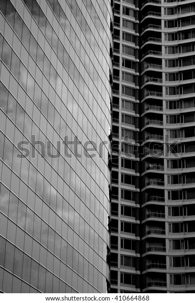 reflection on glass/ office building/ black and white/city