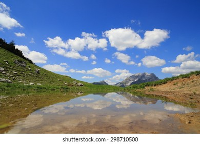 reflection on a lake in the austrian alps - Shutterstock ID 298710500
