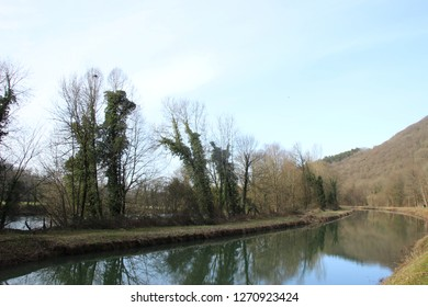 Reflection on the Rhone to Rhine canal near the Doubs rive in Aveney, Franche-Comté, France