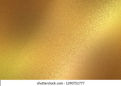 Reflection on rough gold metallic sheet surfaces, abstract texture background