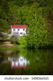 Reflection on a small lake in Oppland Norway