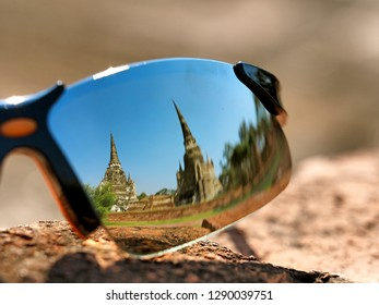 The reflection on a traveller's sunglasses at The Wat Mongkol Bophit,Ayutthaya, Thailand. This place also be one of ayutthaya historical park.