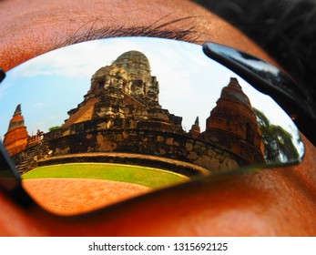 The reflection on a traveller's sunglasses at The Wat Ratchaburana, Ayutthaya, Thailand. This place also be one of ayutthaya historical park.