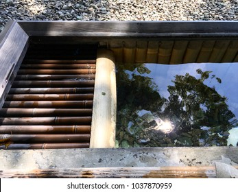 The reflection on the water surface of the bamboo made little pool for foot bath.