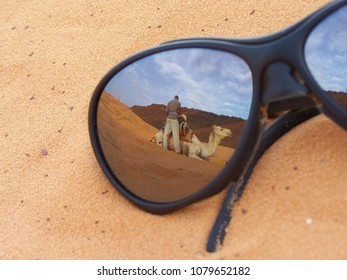 Reflection in a Pair of Glasses - Camel preparation in Mauritania