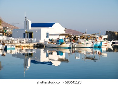 Reflection at the Port os Naoussa with the boats and the little church, Greek Islands