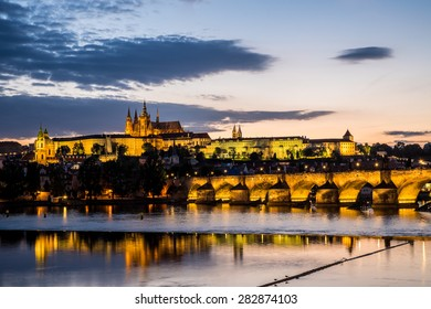 Reflection of Prague caste and the Charles bridge at dusk