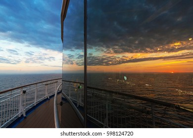 Reflection from the restaurant at a cruise ship with a sunset in the swedish archipelago during summer